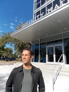 Chris Cano stands in front of Infinity Hall where the office for Gainesville Compost is located. Cano said the building has curated and encouraged the vision of innovation that his business strives for. (Kelsey Jordan/ WUFT News)