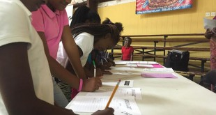 Girls in Alachua register for Dream Girlz on Nov. 5. The new nonprofit provides support for girls and their families. Photo by Trevor Mylin/WUFT News.