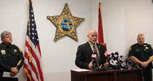 Marion County Sheriff Chris Blair and special agent Dennis Bustle of the Florida Department of Law Enforcement address the investigation of five officers for civil rights violations.  (Carel Lajara/WUFT News.)