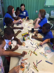 Volunteers work with elementary children at the Boys and Girls Club of Alachua  County. Howard Bishop Middle School will provide similar services once the 'community school' launches during the 2016-2017 school year. (Photo courtesy of Scott Monnett)