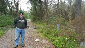 223rd Street. The county proposed to permanently close the roads in a wetlands restoration effort. Matthew Lussier, 50 from Hawthorne, stands on the closed portion of Southeast 223rd Street. (Lucas Wilson/WUFT News)