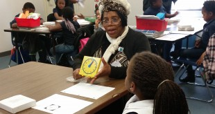 Volunteer Foster Grandparent Dorothy Thompson, 66, teaches one of her foster grandchildren how to tell time at the Caring and Sharing Learning School in Gainesville, Florida. (Photo courtesy of Megan Lang)