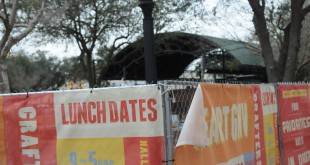 Banners hang on the fence that surrounds Bo Diddley Plaza in downtown Gainesville while the plaza is closed for renovations. It will reopen to the public on March 1, one year after the $1.8 million renovations began. Photo By Jordan McPherson// WUFT News