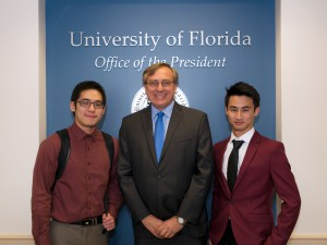 UF president Kent Fuchs (middle) accepts the invitation from the Chinese Student Association to attend the CSA's Chinese Spring Festival Gala. It would be the first time the UF president attends the event and gives a speech. (Courtesy of Jiantao Shen)