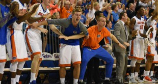 Florida players seated on the bench react to an alley-oop dunk by teammate Devin Robinson (3) in the second half. (Greenberry Taylor/WUFT News)