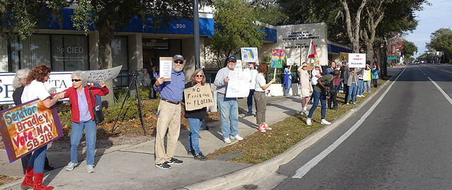 "Gainesville residents rally against fracking outside Senator Bradley's office after the Florida House passed a bill supporting it. The ""No Fracking Way"" rallies happened in 9 cities across the state to urge state senators to vote against it. (Photo courtesy of Jim Tatum)"
