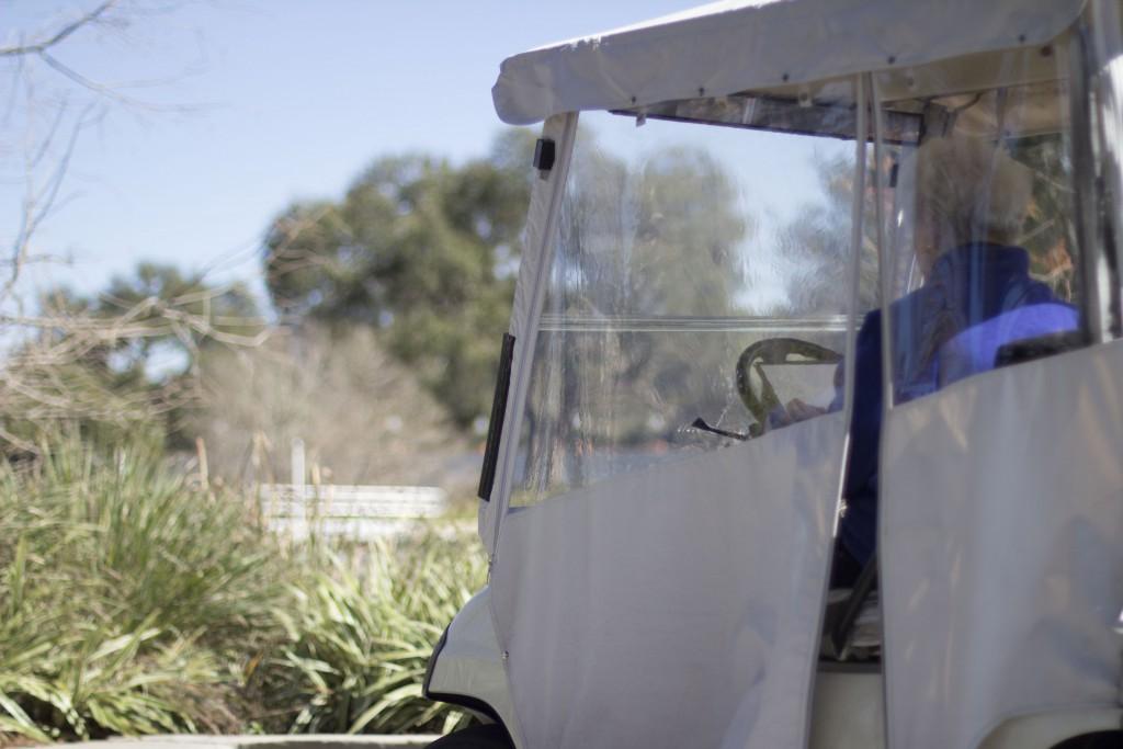 Verdelle 'Freddie' Venturoni sketches landscapes in her refurbished 1999 Yamaha golf cart on Friday at The Villages. For some, like Venturoni, a golf cart is the best means of transportation in The Villages. (Charlie Hatcher/WUFT News)