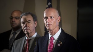 Florida Gov. Rick Scott (right) holds a press conference on Thursday, Feb. 4, at the at the Hillsborough County Health Department after his decision to declare a state of emergency in five counties affected by the Zika virus. Scott explains his plan moving forward and the risk of pregnant women contracting the virus. (Zack Wittman/The Tampa Bay Times via AP)