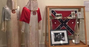 "In 2012, an anonymous donor donated these silk Ku Klux Klan robes to the Matheson History Museum. They are now part of the museum's newest exhibit, ""Long Road to Freedom: The Florida Black History Trail."" (Laura Gomez/WUFT)"