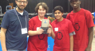 (From left) Purple Penguins coach David Sankey stands with team members Andrew Dodds, Aaditya Vyas and Josh Williams-Caldwell after placing second in the statewide robotics competition Sunday in Tampa. The fourth team member, Cory Smith, isn't pictured. (Photo courtesy Alachua County Public Schools)