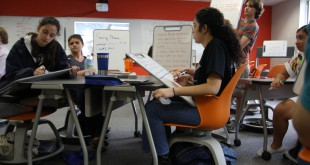 Students engage in discussion using the white boards provided in the active learning classroom. This allows them to effectively share ideas with each other and the teacher. Photo couresty of Julia Neal, P.K. Yonge Developmental Research School