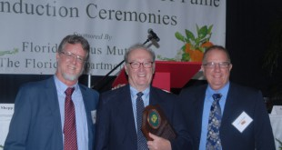 "Florida Citrus Hall of Fame inductee Bill Castle, (center), poses with research colleagues Jude Grosser, (left), and Fred Gmitter, (right). ""What I have to say I enjoy most about Dr. Castle is that he's an optimist and a kind gentleman who always tries to take the high road,"" Gmitter said. (Ron O'Connor/Farm Credit"