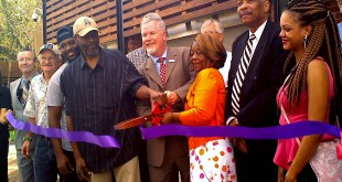 Gainesville Mayor Ed Braddy and Evelyn Cooper, Bo Diddley's daughter, cut the ribbon together at the opening ceremony of Bo Diddley Plaza Thursday morning. The plaza recently got a $1.8 million, year-long renovation. Glenn Kennelly/ WUFT News.