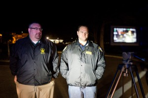 From left, Alachua County Sheriff's Office spokesman Lt. Brandon Kutner and Gainesville Police Department spokesman Officer Ben Tobias prepare for an early press conference Monday.