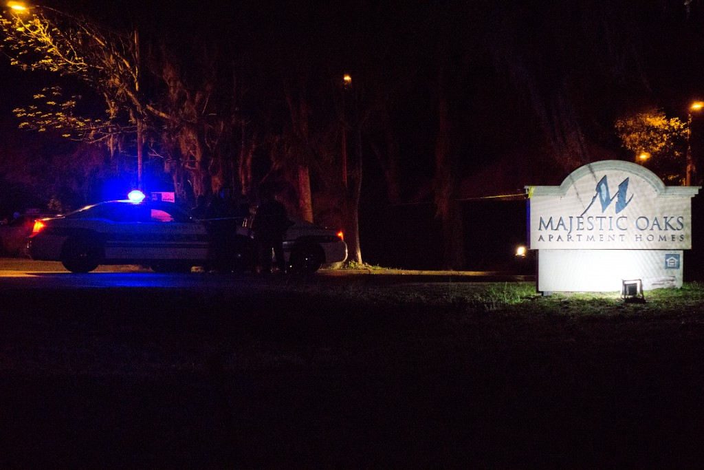 Gainesville Police monitor the entrance of Majestic Oaks Apartments at about 3:40 a.m. Monday.