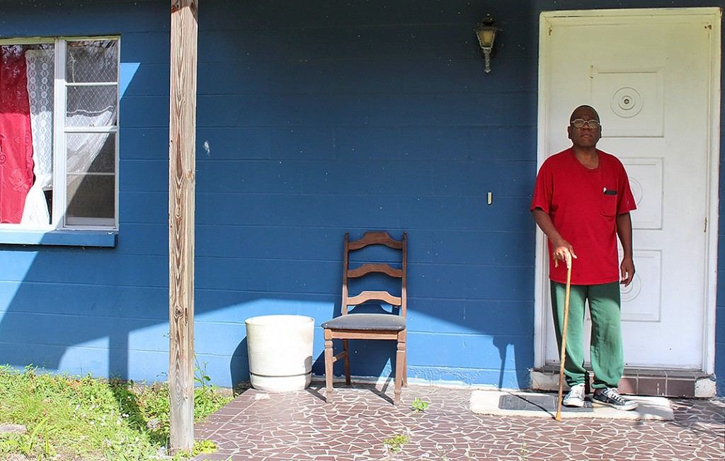 "William Elliott stands outside his house. He said he's lived here for 43 years. ""I have all of my life and all of my money tied up in this home and this property,"" he said. ""Everything I have in the world is right here, I don't have anywhere else to go."""