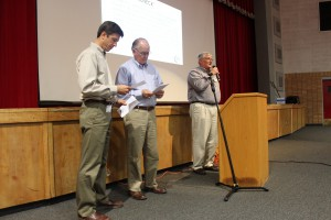 HPS Enterprises LLC representatives (from left) Ed Murawski, Julian Hazen and Jack Schmedeman read audience questions on Monday about the company's proposed phosphate mining operation in Bradford and Union counties. (Martin Vassolo/WUFT News)