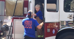 Riley getting out of the newer fire engine.