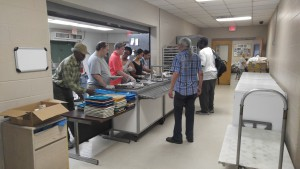 St. Francis volunteers help serve food at the homeless shelter in February. The shelter serves meals three times a day and about 100,000 annually. (Brittney White/WUFT News)