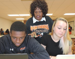 Angela Wright, a computer lab proctor at Hawthorne Middle/High School, works with students. Wright was named this week as one of five finalists for the Florida School-Related Employee of the Year Program award. (Photo courtesy Alachua County schools)