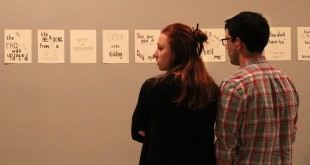 "WORD ART — Courtney Mcgovern, 21, and Daniel Diaz, 21, support their friend, Wes Riley, whose art was shown at The Wooly on Friday. ""It's all very unique,"" Mcgovern said. (photo by Christena Carollo)"