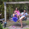 A family takes a break and sits in a swing next to the herb garden on Sunday, April 17. (Alexandra Booth/WUFT News)