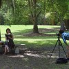 A couple does a photo shoot in the Conifer Garden on Sunday, April 17, which features many types of trees that produce seeds. (Alexandra Booth/WUFT News)
