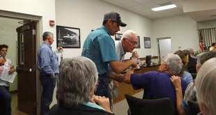 Bradford County residents break into a fight during county commission meeting at which the possibility of phosphate mining by HPSII Enterprises was discussed.