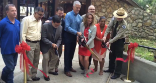 Park officials and rangers cutting the ribbon to mark the grand opening of the remodeled visitor's center.
