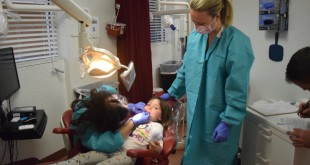 Harper Melosh, 4, gets her teeth checked by UF Health pediatric residents on Thursday. (Alexandra Booth/WUFT News)
