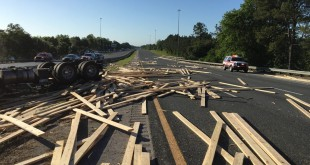 All lanes are blocked on I-75 at Newberry Rd. in Gainesville due to a crash involving two semi-trucks and a vehicle.