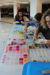(Left to right) sophomore Daniella Pareja, post BAC student Karley Post and Post's mother Susie Osborne pick out beads for earrings. (Photo courtesy of Carson Smith.)