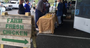 A sign at the Alachua County Farmers Market points to fresh chicken. The coins distributed by the Fresh Access Bucks initiative applies to products that are fresh food certified, which is typically only fruits and vegetables.