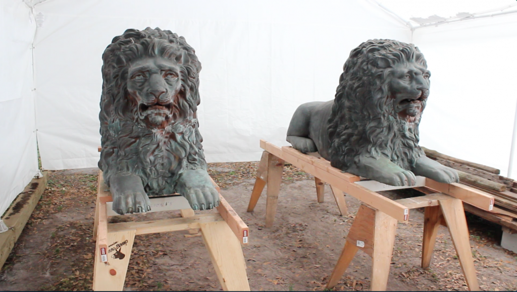 The former Alachua County Courthouse lions — after artist Tom Thomas completed his restoration work. (Aaron Abell/WUFT News)