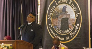The Rev. Karl Anderson speaks during the Ninth Annual Martin Luther King, Jr. Prayer Breakfast at the Best Western Grand Hotel on Friday. Anderson said the thrust of his message was to challenge people to get involved with the community and in politics.