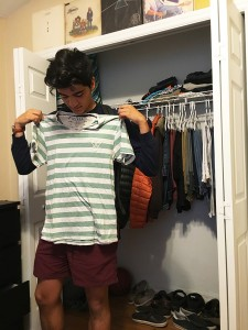 "Eastside senior Juan Mejia showcases a collarless shirt that violates Alachua County's school dress code policy. ""I think it's kind of silly because nothing's really exposed,"" he said."