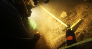 In this 2015 photo provided by Texas A&M's Center for the Study of the First Americans, divers investigate the Page-Ladson archaeological site in Florida. Scientists say artifacts found deep underwater in a Florida sinkhole show people lived in that area some 14,500 years ago. That makes it the earliest well-documented site for human presence in the southeastern U.S., and important for understanding the settling of the Americas, experts said. (S. Joy/CSFA via AP)