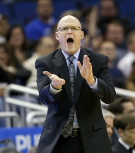 FILE - In this Feb. 16, 2016, file photo, Orlando Magic head coach Scott Skiles encourages his players during the second half of an NBA basketball game against the San Antonio Spurs, in Orlando, Fla. Skiles has stepped down as coach of the Magic. Skiles was 35-47 this season, his lone year leading the Magic. The team made the surprising announcement Thursday morning, May 12, 2016, saying Skiles informed them that he would not be returning. (AP Photo/John Raoux, File)