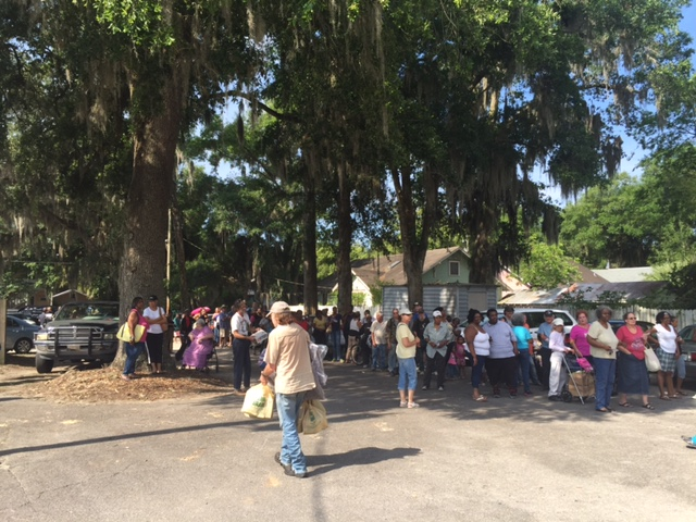 Hundreds of people turned out for a food giveaway by the Jacksonville branch of Farm Share Inc. at the Salvation Army on East University Tuesday. (TJ Pyche / WUFT News)