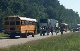 An Alachua County Public school bus (left) arrives to transport students to school Tuesday after a semi truck hit a stopped school bus injuring a middle school student who is in serious condition at UF Health Shands Hospital.  (TJ Pyche/WUFT News)