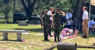 Members of the Milton Lewis Young Marines perform the flag folding ceremony at Evergreen Cemetery. They told of the significance of the 13 step process detailing the meaning to each of the folds.Milton Lewis' family members & members of the Milton Lewis Young Marines honor his name with a wreath-laying ceremony. For his valor and devotion during the Battle of Tulagi, Corporal Lewis was awarded the Navy Cross posthumously.