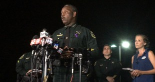 Orange County Sheriff Jerry Demings speaks at a news conference about a 2-year-old boy who was dragged into the water by an alligator on the shores of Disney's Grand Floridian Resort & Spa Tuesday night in Orlando. The family of five from Nebraska was on vacation and wading in a lake Tuesday evening when the attack happened, Demings told a news conference. The father tried to rescue his son but was unsuccessful, Demings said. (Christal Hayes/Orlando Sentinel via AP)