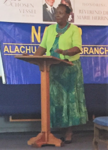 Evelyn Foxx, president of the Alachua County Branch of NAACP, moderates on Monday the community meeting held at Dayspring Missionary Baptist Church, 1945 NE 8th Ave. (Bria Wood/WUFT News)