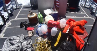 This photo made available by the U.S. Coast Guard shows personal items that were recovered within a debris field off the coast of Sanibel, Fla., Wednesday, June 22, 2016. The personal items are believed to belong to a father and his three teenage children who were reported missing while they were aboard a sailboat in the Gulf of Mexico. (U.S. Coast Guard via AP)