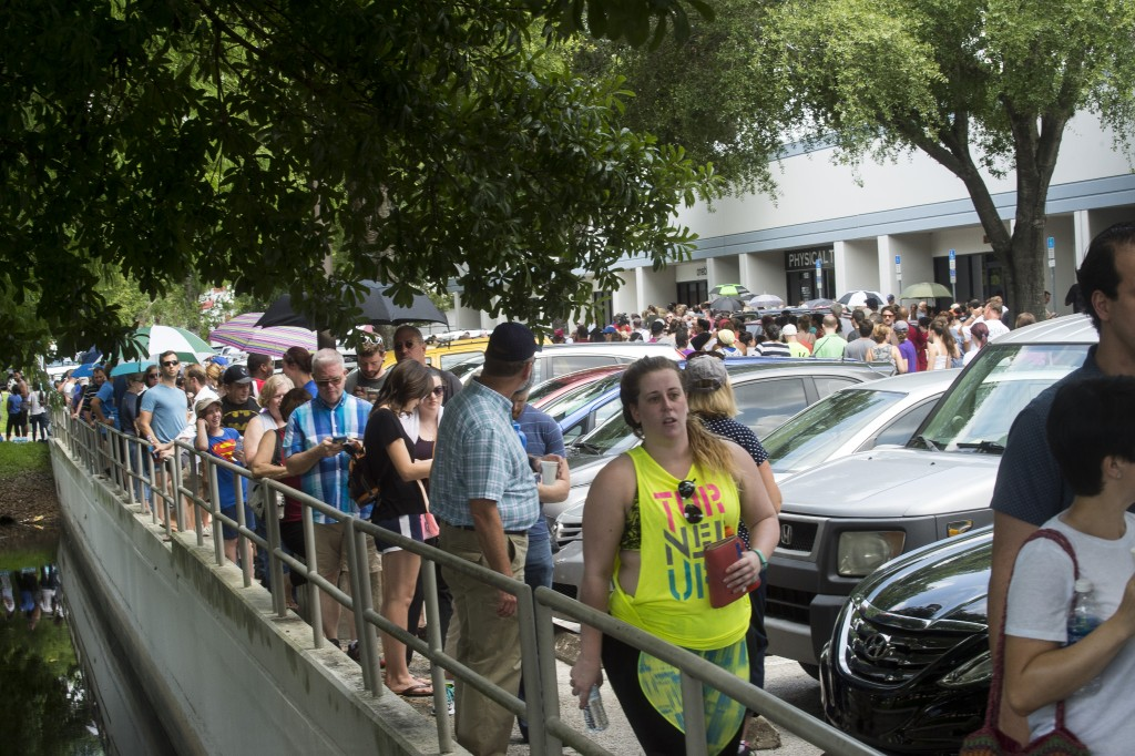 Hundreds of volunteers line up to donate blood at OneBlood Center after the late night shooting at Pulse, an Orlando night club, Sunday, June 12, 2016, in Orlando. A gunman wielding an assault-type rifle and a handgun opened fire inside a crowded Florida nightclub before dying in a gunfight with SWAT officers, police say. The attack left at least 50 people dead, making it the worst mass shooting in American history. (Zack Wittman/Tampa Bay Times via AP)