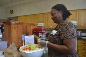 Rita Parrott of Naylor Association Solutions helps prepare a chef salad for the families staying at the Ronald McDonald House of Gainesville. The Visiting Chef Program allows volunteers to cook a home-cooked meal for the residents at the house. (Brittany Valencic/WUFT News)