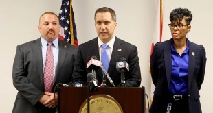 Palm Beach County State Attorney Dave Aronberg speaks during a news conference as chief assistants Brian Fernandes and Adrienne Ellis listen in West Palm Beach, Fla., Wednesday, June 1, 2016.  Fired officer Nouman Raja was arrested and charged with attempted murder and manslaughter in the Oct. 18, 2015, death of Corey Jones, 31, after a grand jury found the shooting was unjustified, Aronberg said at the news conference. (Allen Eyestone/Palm Beach Post via AP)