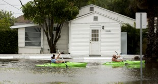 Kayakers paddle south down Palm Street in Madeira Beach, Fla., in flooding from Tropical Storm Colin, Monday, June 6, 2016.  (Cherie Diez/The Tampa Bay Times via AP)