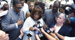 U.S. Rep. Corrine Brown addresses the media outside the Federal Courthouse, Friday, July 8, 2016, in Jacksonville, Fla. Brown and her chief of staff have been charged with multiple fraud and other federal offenses in a grand jury indictment unsealed Friday. (Bob Self/The Florida Times-Union via AP)
