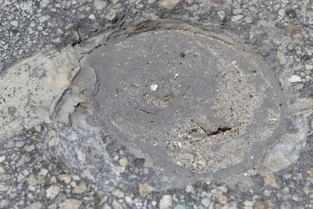 A couple hundred holes have been drilled into Newberry Road as part of a three-mile long construction project. (Lauren Johnson/WUFT News)